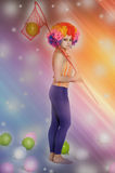 Girl clown and balloons Royalty Free Stock Image