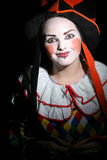 Girl in clown costume. Portrait of a teenage girl in a clown costume.  Black background Stock Images