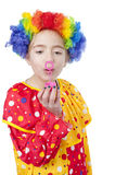 Girl in clown costume blowing air bubbles Royalty Free Stock Photography