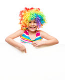 Girl in clown is holding blank banner Stock Photography