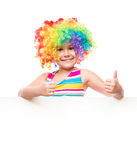 Girl in clown is holding blank banner Stock Image