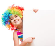 Girl in clown is holding blank banner Royalty Free Stock Photo