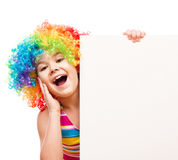 Girl in clown is holding blank banner Stock Images