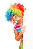 Girl in clown is holding blank banner Stock Photo