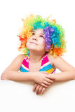 Girl in clown is holding blank banner Royalty Free Stock Images
