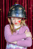 Girl in Clown Make Up and Helmet with Arms Crossed Royalty Free Stock Photos