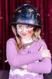 Girl in Clown Make Up and Helmet with Arms Crossed Royalty Free Stock Image
