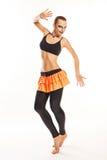 Girl with clown makeup dances Stock Images