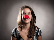 Girl with a clown nose Stock Image