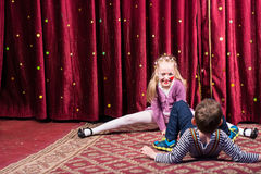 Girl Clown Performing Splits on Stage Royalty Free Stock Images