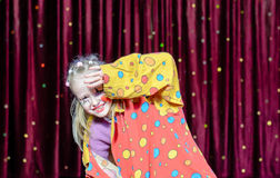 Girl Clown Shielding Eyes from Bright Stage Lights Stock Photos