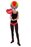 The girl in a clown suit holding a red heart Stock Photography