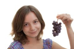 Girl with cluster of grapes Stock Photography