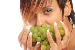 Girl with a cluster of green grapes Royalty Free Stock Photo