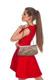 Girl with a clutch Royalty Free Stock Photography