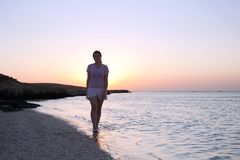 Girl at coast sea  during  sunrise Royalty Free Stock Photography