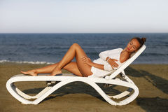 The girl on coastline Stock Photos