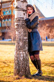 Girl in coat in autumn birch Stock Photography