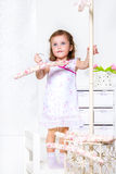 Girl with a coat hanger Royalty Free Stock Photos