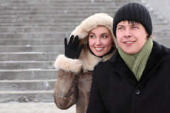 Girl in coat with hood and man smiling Stock Photo