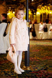 Girl in coat stands near to lamp post Stock Photography