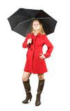 Girl in  coat with umbrella Stock Image