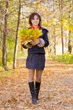 Girl in coat walking  in autumn Royalty Free Stock Photos