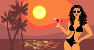 Girl with a cocktail on the beach. Stock Photography