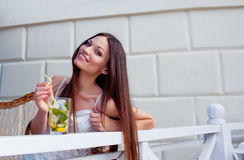 Girl with cocktail in cafe Royalty Free Stock Photography