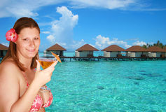 Girl with cocktail in holiday Stock Photography