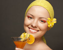 Girl with a cocktail from oranges Stock Photos