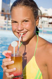Girl with a cocktail at pool Stock Photos