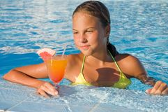 The girl with a cocktail at pool Stock Photography