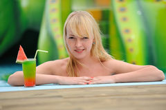 Girl with a cocktail Stock Images