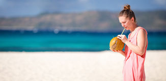 Girl with coconut Royalty Free Stock Photography