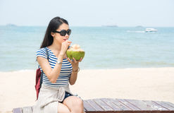 Girl with coconut on a beach Royalty Free Stock Images