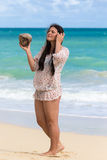 Girl with coconut in hand Stock Photography