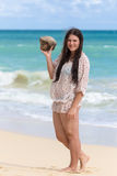 Girl with coconut in one hand Royalty Free Stock Image