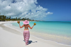 Girl with coconuts at a beach Royalty Free Stock Photos