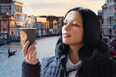 Girl with coffee on the background of the river and city. Girl with coffee on the background of the river stock photos
