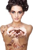 Girl with coffee beans Royalty Free Stock Photography