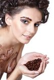 Girl with coffee beans Royalty Free Stock Images