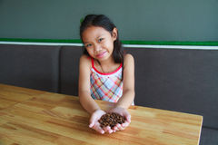 Girl and coffee beans Stock Image