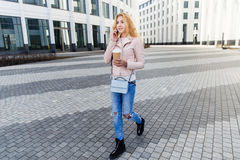 Girl with coffee on city Royalty Free Stock Images