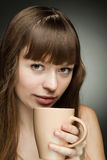 Girl with coffee cup Stock Photos