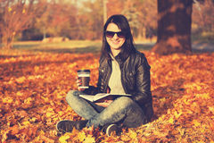Girl with coffee cup and book Royalty Free Stock Photo