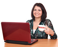 Girl with coffee and laptop Stock Photos