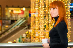 Girl with a coffee in the mall Stock Image