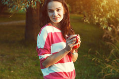 Girl with coffee in park Royalty Free Stock Photos