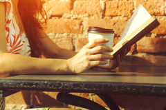 Girl with coffee reading book Stock Images